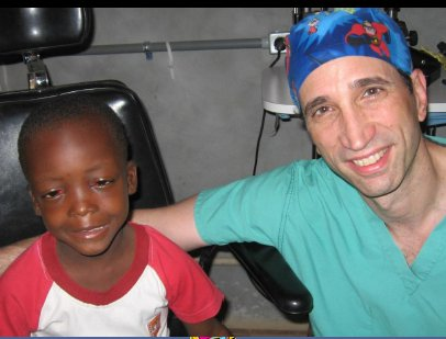 Haiti - Dr. Blatt with pediatric patient